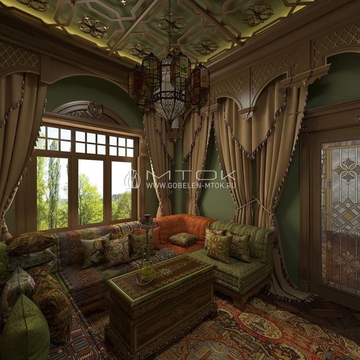 Интерьер уютной кальянной с низкими диванами, обитыми шениллом и гобеленом